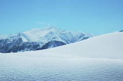 Snowdrift in bright winter day Royalty Free Stock Photography