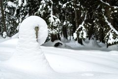 Snowdrift on a post Royalty Free Stock Image