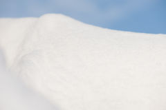 Snowdrift on sky background Royalty Free Stock Image