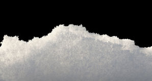 Snowdrift structure. Closeup of snowbank isolated on black Stock Photo