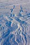 Snowdrift and tire tracks Stock Images