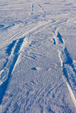 Snowdrift and tire tracks Royalty Free Stock Image
