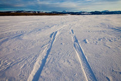 Snowdrift and tire tracks Royalty Free Stock Images