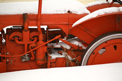 Snowdrifts against antique farm tractor Royalty Free Stock Image