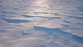 Snowdrifts at contre-jour lighting, sunset Royalty Free Stock Images