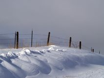 Snowdrifts and Fence Stock Photos