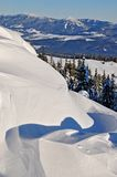 Snowdrifts on a hillside. Stock Image