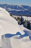 Snowdrifts on a hillside. Stock Image