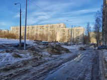 Snowdrifts and ice along the sidewalk in a residential area. Russia, St. Petersburg 15,02,2019 Snowdrifts and ice along the sidewalk in a residential area stock photo