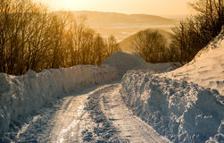 Snowdrifts and rural road Stock Photography