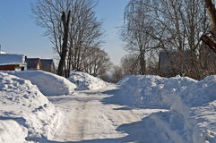 Snowdrifts in russian village Royalty Free Stock Image