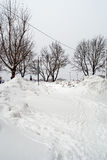 Snowdrifts in the street Royalty Free Stock Images
