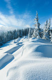 Snowdrifts on winter snow covered mountainside Royalty Free Stock Images