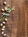 Snowdrop with chocolate egg Royalty Free Stock Images