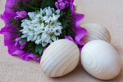 Snowdrop flowers and wooden eggs. Greeting card Royalty Free Stock Photos