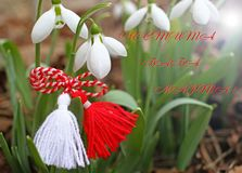 Snowdrop spring flowers with martenitsa. Baba Marta day stock photo