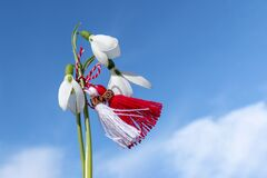 Free Snowdrops And Martenitsa Against The Blue Sky. Martisor. Baba Marta Day - Bulgarian Holiday. Concept. Copy Space Stock Photography - 171307732