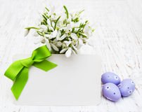 Snowdrops, easter eggs and greeting card Royalty Free Stock Photography
