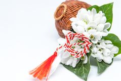 Snowdrops and red and white string martisor on white with copy space east european first of march tradition celebration Stock Photos