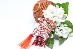 Snowdrops and red and white string martisor on white with copy space east european first of march tradition celebration Royalty Free Stock Images