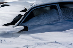 Snowed in. Car covered up to windows in snow Royalty Free Stock Photo