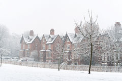 Snowed in. A row of houses in falling snow royalty free stock image