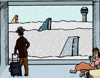 Snowed In At the Airport. Scene of a man and woman at an airport departure gate with airplanes covered in deep snow Stock Image