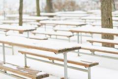 Snowed benches in winter park. Snowed wooden benches in winter park Royalty Free Stock Photography