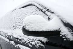 Snowed car in winter. Snowed windscreen of a dark car in winter royalty free stock photos