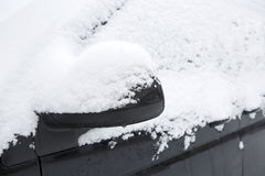Snowed car in winter. Snowed windscreen of a dark car in winter stock photo