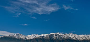 Snowed Cordillera mountains in Santiago Chile. Cordillera de los Andes in Chile on the beginning of winter with a blue sky Stock Photos