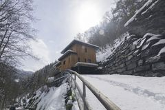 Home in the snowy mountains in Switserland. Snowed in home in Swiss mountains Royalty Free Stock Photos