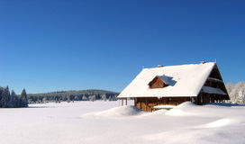 Snowed house in the mountains royalty free stock photo