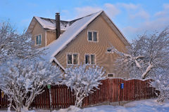 Snowed house in Russia Royalty Free Stock Photos
