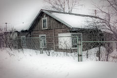 Snowed house in Russia Stock Photos