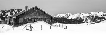 Snowed-in mountain hut in the Allgäu Alps. Romantic mountain hut in deep snow Stock Photography