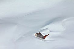 Snowed-in mountain hut in the Alps. Romantic hut covered by snow Royalty Free Stock Photography