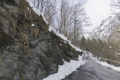 Snowed in mountainroad in Switserland. Snowed in mountain road in Switserland Royalty Free Stock Photo