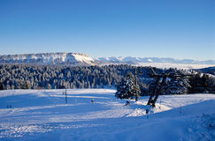 Snowed mountains of Feclaz and Margeriaz near Chambery, France Royalty Free Stock Image