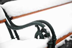 Snowed park bench Royalty Free Stock Images