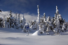 Snowbound Parking lot with traffic sign Stock Photos
