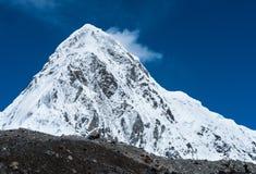 Snowed Pumori summit in Himalaya. Travel to Nepal royalty free stock photo