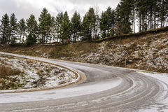 Snowed Road Passing through Forest Royalty Free Stock Photo