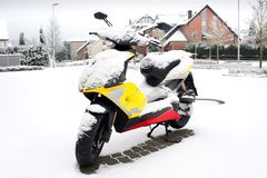 Snowed scooter Stock Image