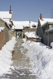 Snowed street after snow storm. House on a sunny winter day. Snowed street after snow storm Royalty Free Stock Photography