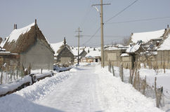Snowed street after snow storm. House on a sunny winter day. Snowed street after snow storm Royalty Free Stock Image