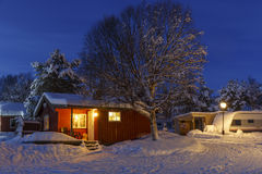 Snowed up wooden cabin Stock Photography