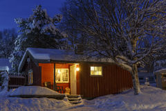 Snowed up wooden cabin Royalty Free Stock Photos