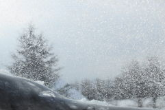 Snowed window and blur landscape Royalty Free Stock Photo