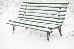 Snowed wooden bench Stock Images